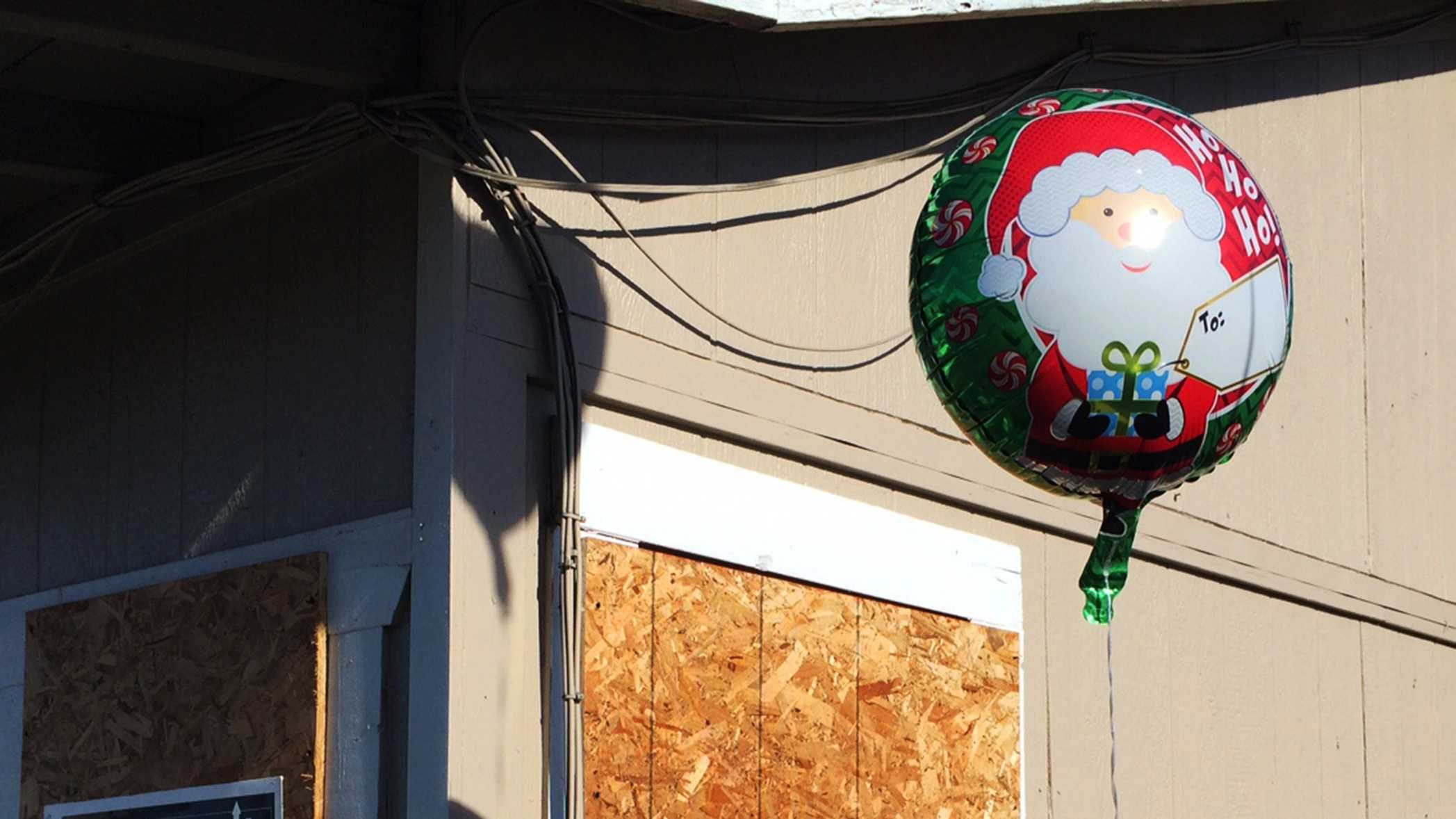 Someone hung three Christmas stockings at 501 Fremont Street for the two homicide victims and their beaten 9-year-old sister.