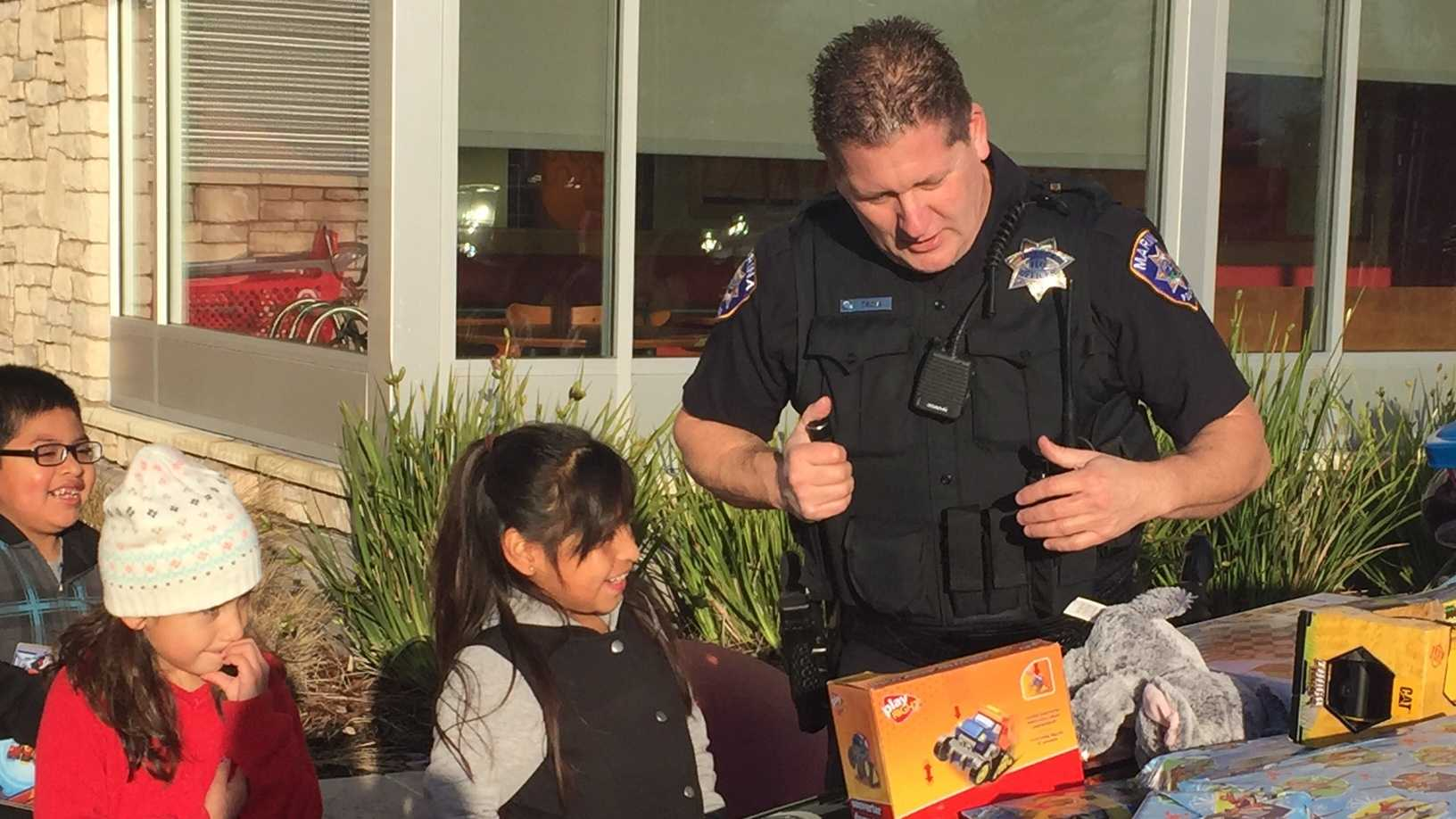 KSBW Police hand out toys.JPG