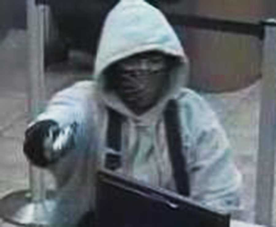 """GREENFIELD -  On June 12, 2015, four people robbed the Wells Fargo Bank Branch located at 560 Walnut Avenue in Greenfield. They used a """"takeover"""" tactic while threatening everyone inside. The robbers used a green van as the getaway car."""