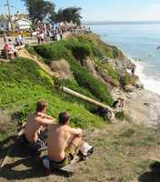 Local skateboarders stop to watch filming at Pleasure Point. (Oct. 14, 2011)