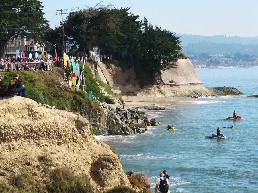 Surfers make their way down the cliffs on East Cliff Drive to paddle out for a movie shoot. (Oct. 14, 2011)
