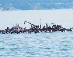 "A thousand local surfers acted as extras while a Hollywood movie crew shot ""Chasing Mavericks"" at Pleasure Point in Santa Cruz. (Oct. 14, 2011)"