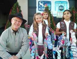 Kids give their donations to KSBW Weatherman Jim Vanderzwaan in Hollister.