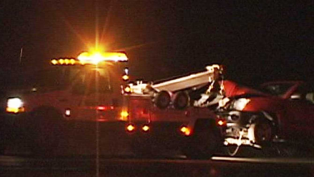 One car in the triple-fatal crash on Highway 101 in King City is towed away. (Feb. 22, 2012)