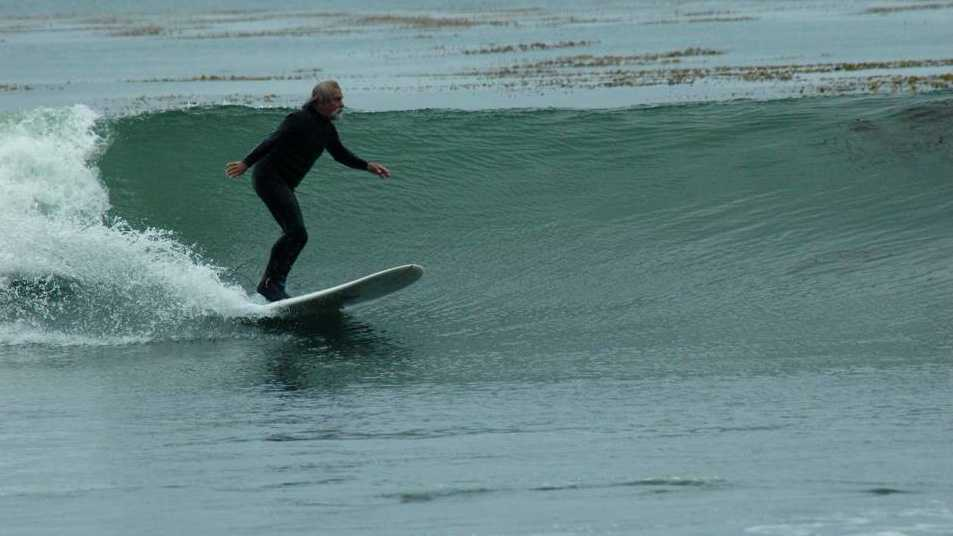 Scott Woodworth is seen surfing in December.
