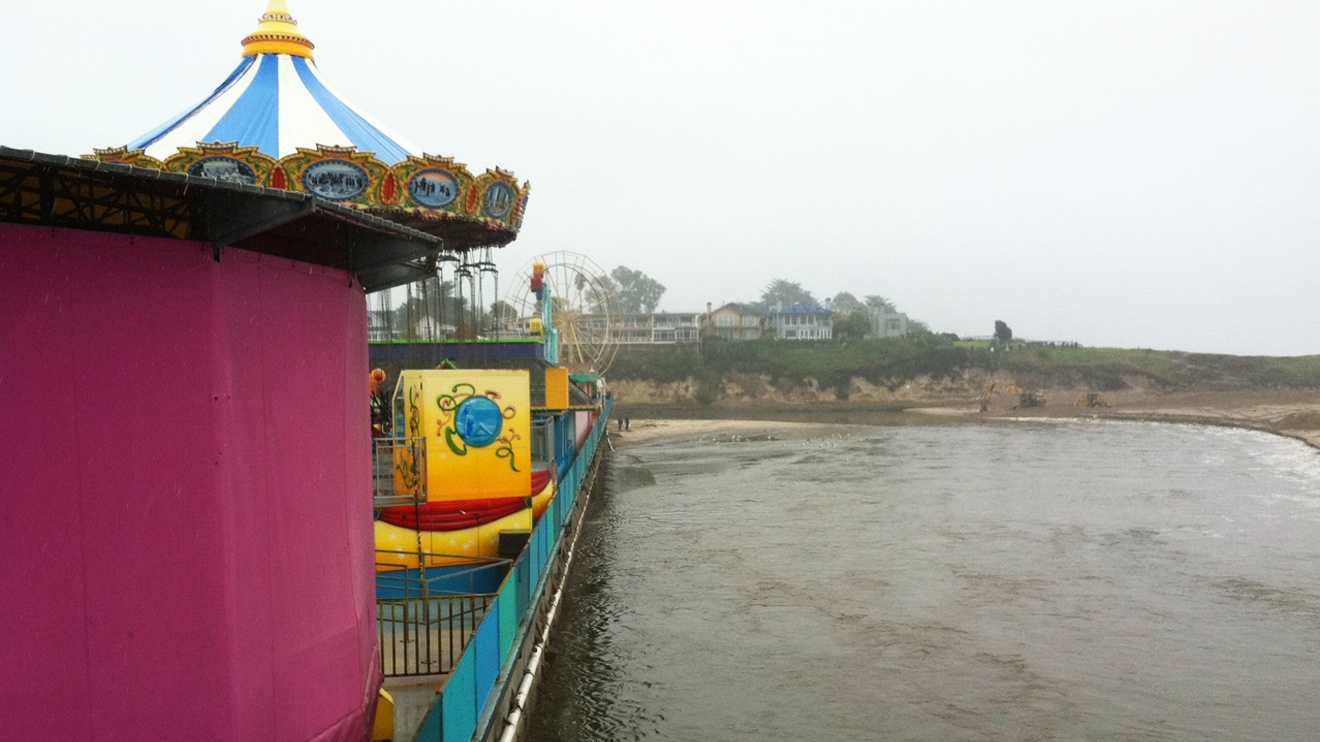 The San Lorenzo River came close to flooding the Santa Cruz Beach Boardwalk after Wednesday's storm. (March 15, 2012)
