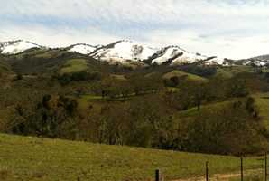 Mountains above Carmel Valley are dusted with snow. (March 19, 2012)