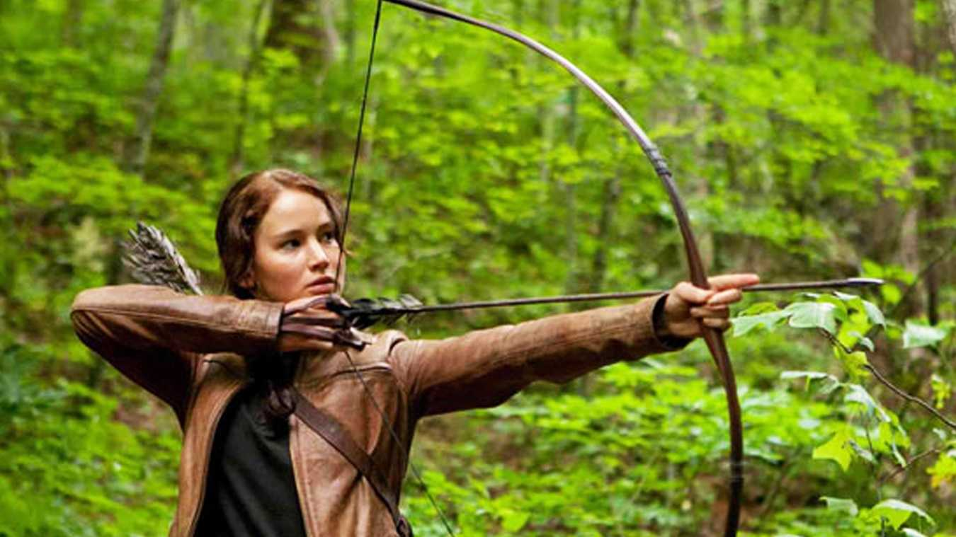 "Jennifer Lawrence portrays character Katniss Everdeen in the movie ""The Hunger Games."""