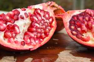5. Deseed a pomegranate quickly and easily by cutting it in half and then banging on the outside of it with a wooden spoon. To speed up the process even further, try gently hitting and rolling the fruit around prior to cutting it in half&#x3B; this will break the inner membranes and loosen up the seed.