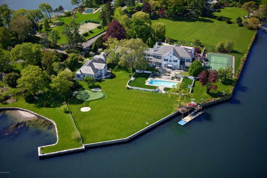 The home is located on the Long Island Sound and includes a beautiful pool in addition to a tennis court overlooking the water.