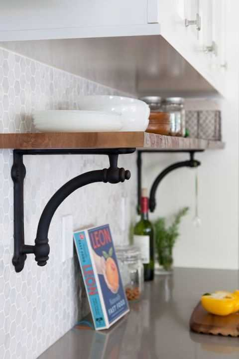 Add Another LevelIf you feel strongly about keeping all of your most-frequently-used items out and visible (instead of stashed behind cabinet doors) but don't have counter space to waste, add a level of shelves on your backsplash to store those items.See more at The House Diaries »