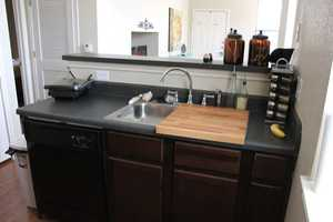Use Your Sink for More Than WaterThis wooden cutting board fits snugly on top of one side of your sink (while the other half remains open in case someone needs some H2O) and is especially handy if you have a wide sink that takes up more than half of the counter area (like this one!).See more at Sweet Verbena »