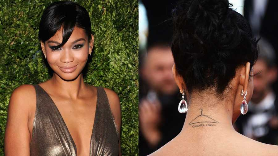 Chanel ImanIman has a hanger sketched along the back of her neck with her name written beneath it.