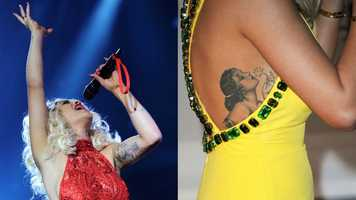 "Rita Ora Ora is covered in tattoos, from an Alberto Vargas-inspired pin-up girl on her left ribcage to a portrait of Aphrodite, the goddess of love, holding Ora's heart on her left bicep. The singer also has wings on her ankle, a Sagittarius sign behind her left ear and ""love me"" on her right wrist, among others."