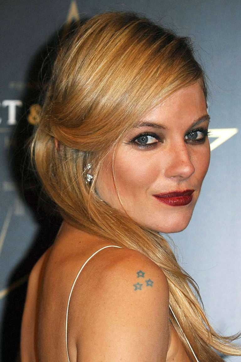 Sienna Miller Miller has a trio of stars on her right shoulder, another single star on her hip, and a swallow in flight on her left wrist.