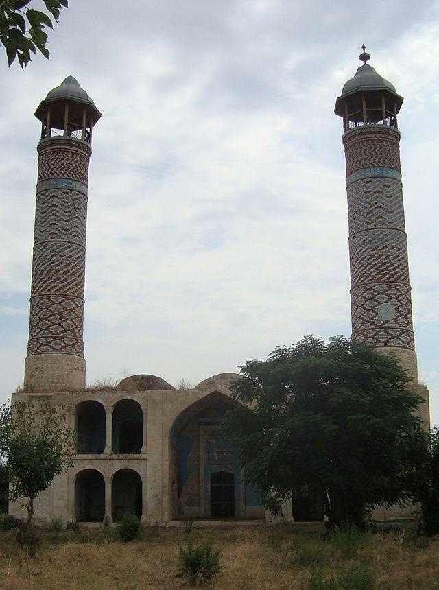 The only building that remains intact is the mosque covered with graffiti.