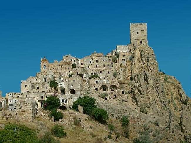Craco is a medieval village located at the instep of the boot of Italy. The hill town was built with mildly rippling shapes and the lands surrounding it farmed wheat and other crops.
