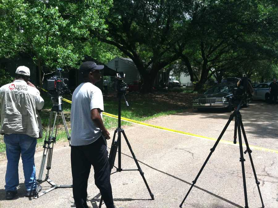 The man, who has not been identified, was shot twice by another man who ran from the house, police said.