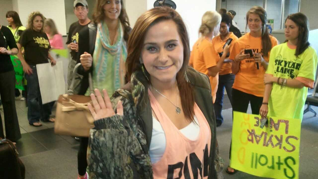 Skylar Laine is greeted by fans at the Jackson Evers International Airpot.