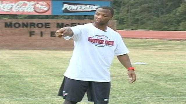 Houston Texans defensive back Glover Quin teaching the basics at his first football camp in Summit, MS