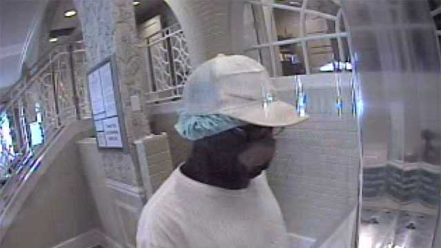 The man shown in the surveillance photos may also be a suspect in two other bank robberies, police say.