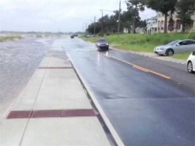 Isaac pushes water onto Beach Front Road in Waveland.