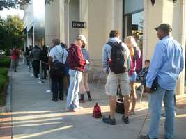 Crowds lined up early at the Apple store at Renaissance at Colony Park to buy the new iPhone 5.