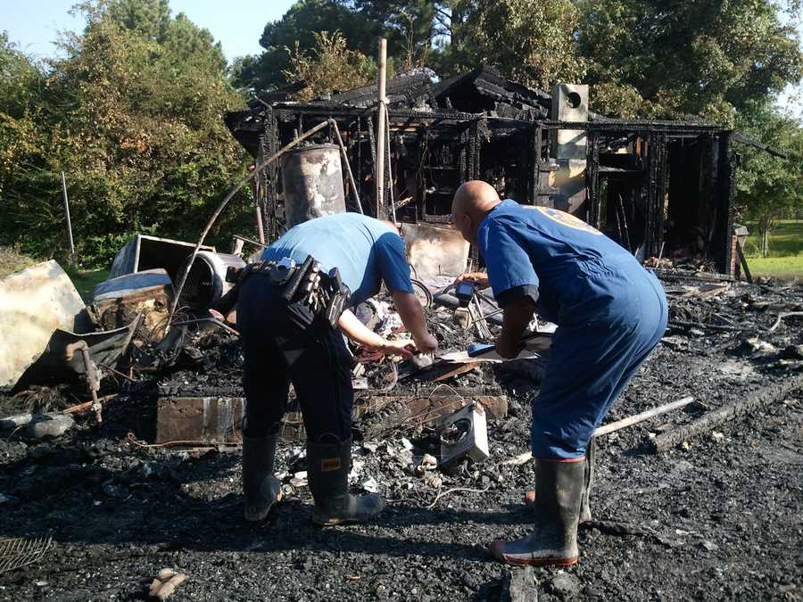 One of the brothers tried to put out the fire, but was overcome by smoke and became trapped, fire officials say.