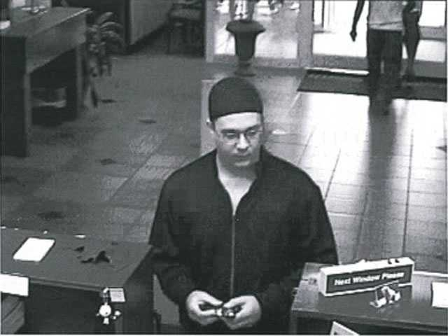 Madison police are searching for a man wanted in a morning bank robbery.