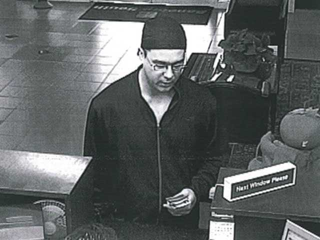 The man was described as white and wearing eye glasses, a dark colored jogging suit with a white stripe on the legs, and white tennis shoes.