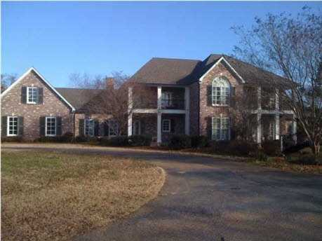 take a tour of this beautiful gated home with five fireplaces, three car garage that sits on fifty acres in Clinton, MS featured on realtor.com