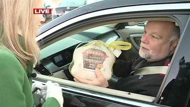 Capt. Ken Chapman, of the Salvation Army, donates a turkey.