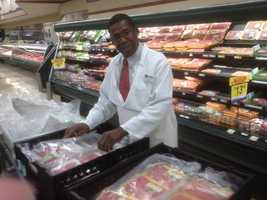 Singing butcher Melvin Jamison helps out with Turkey Drive 16.