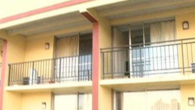 A man is fighting for his life after police say he was thrown from a hotel balcony.