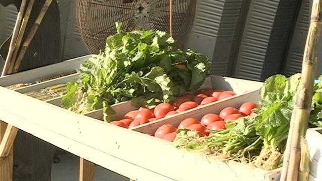 Hinds County inmates sell vegetables grown on the penal farm at a produce stand on Highway 18 in Raymond.