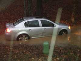 Warren County emergency crews rescued a mother and daughter from this flooded car on Woodbine Road.