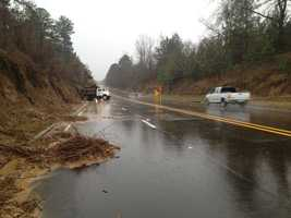 Crews work to clean up a mudslide in Natchez.