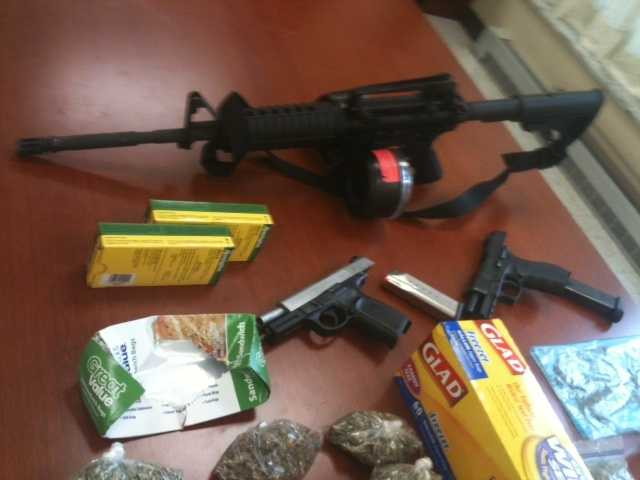 """Two 9 mm semi-automatic weapons and an """"AR-15 style assault rifle"""" were seized, the Sheriff's Department said."""