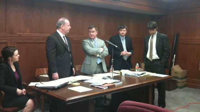 Greg Davis, center, speaks to his attorneys