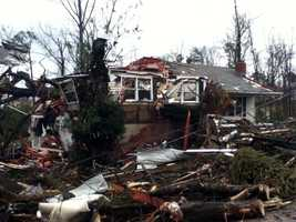 A tree through a house in west Hattiesburg.