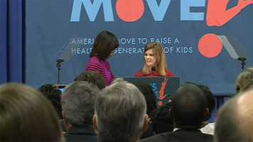 First Lady Michelle Obama thanks 8th grader Emma Scott for her introduction.