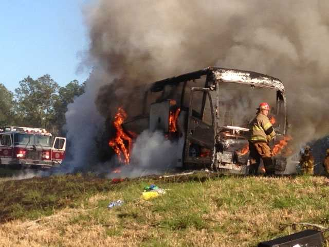 A tour bus carrying 40 Holmes County residents burns on an Alabama highway.