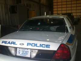 Pearl officials say 25-30 police cars were damaged by hail.