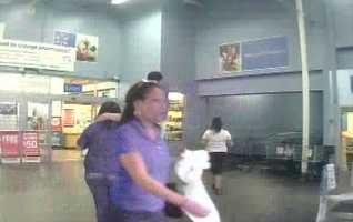 Police say the possible suspect is a black female shown here wearing a royal blue shirt, blue jeans and braids in her hair.