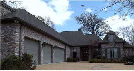 Take a tour of this four bedroom, four bathroom home built in 2003! The home features a four car garage, two indoor fireplaces, plus an outdoor fireplace for entertaining. The home is listed for $590K and featured on realtor.com