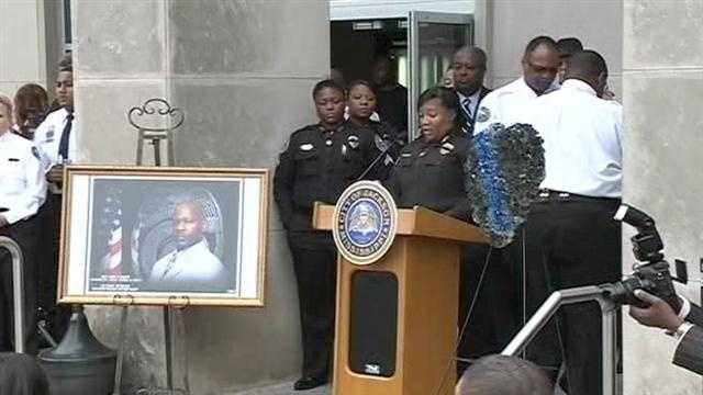 About 100 officers, city officials and Jackson residents gathered Thursday night outside JPD headquarters.