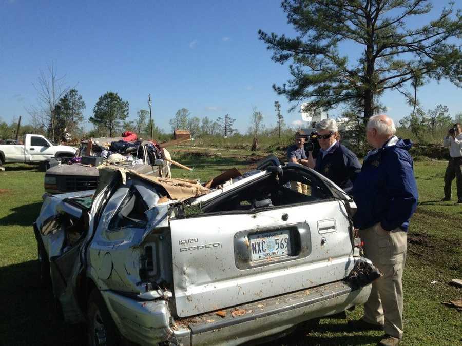 Gov. Bryant and MEMA Director Robert Latham inspect tornado damage.