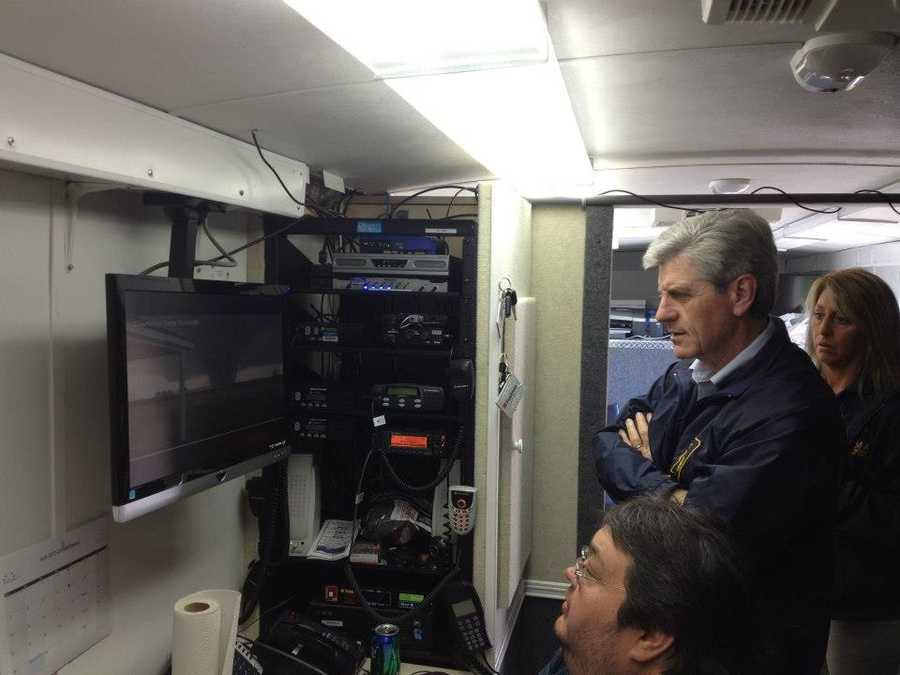 Gov. Bryant viewing tornado footage with MEMA staff.