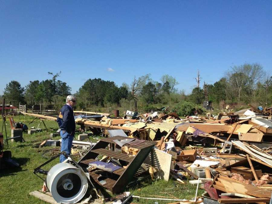 Gov. Phil Bryant assesses damage in Noxubee County, the day after a tornado touched down there.