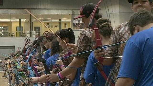 Archers line up to compete in the 2013 AIMS-NASP State Championships.